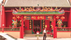 Entrance to Small Indian Temple from Busy Street Stock Footage