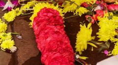 Woman Hands Compose Yellow Red Flower Garland - stock footage