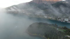 New Zealand Epic Fly Through Clouds Revealing Queenstown at Sunset 002 Stock Footage