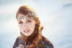 Portrait of the young girl with a tiara in winter - stock photo
