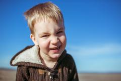 A boy is smiling for the camera Stock Photos