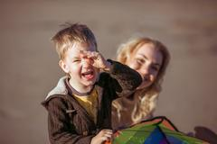 A boy is smiling closing his  eye with the hand Stock Photos