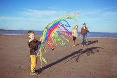 A boy is hollding a kite in his hands Stock Photos