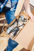 Human with screwdriver and nails. DIY. - stock photo