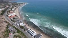 Aerial View of Malibu Beach with crashing waves Stock Footage