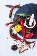 Assortment of hot chili peppers Stock Photos