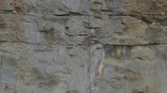 Rising High Above Rock Climber at Top of Cliff 001 Stock Footage