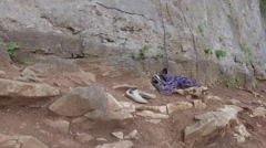 Rising High Above Rock Climber at Top of Cliff 003 Stock Footage