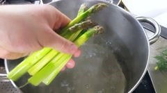 Chef is blanching fresh, green aspargus, at a restaurant kitchen Stock Footage