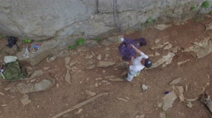Rising High Above Rock Climber Descending Stock Footage