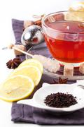 Cup of tea with lemon over white - stock photo