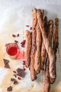 Grissini bread and red liqueur Stock Photos