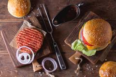 Burger and raw cutlet - stock photo