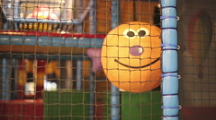 The funny ball with smile is in the children's playroom. - stock footage