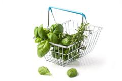 Food basket of herbs - stock photo