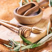 Olive wood kitchen utensil - stock photo