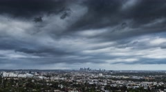 Zoom in on city of Los Angeles skyline rainy storm clouds gloomy cityscape 4K Stock Footage