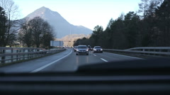 The car goes on the road to the peas. View from the back window of the car. - stock footage