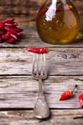 Red hot chili pepper on fork Stock Photos