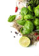 basil and lime over white - stock photo