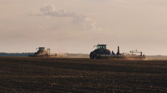 Two tractor ride through the field. Lead planting - stock footage