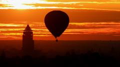 Bagan Nan Myint Tower and hot air balloon at dawn, 360 viewing tower of Bagan, M Stock Footage
