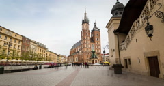 Market square with historic church, cloth hall in Krakow, Poland Stock Footage