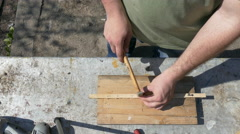 Carpenter nailing wood planks using hammer and steel nails Arkistovideo