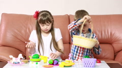 children playing on the couch. girl with Down syndrome. rehabilitation of the - stock footage