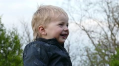 Close up portrait of a happy little boy funny laughing outdoo Stock Footage