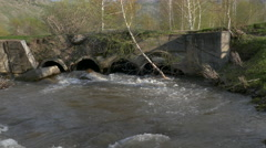 In the spring fresh river flows from pipes Stock Footage