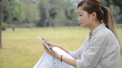 Happy woman using a tablet pc - stock footage