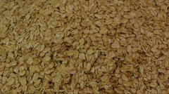 Oat flakes background, top view - stock footage