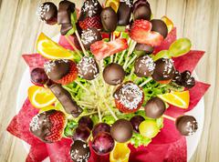 Fruit bouquet with chocolate frosting, special gift - stock photo