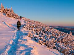 Sunset trip in winter mountains - stock photo