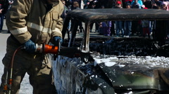 Firefighers cutting the with a hydraulic rescue cutter at a extrication Stock Footage