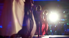 Group models in lingerie on the catwalk is in the spotlight in the night show Stock Footage