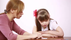 Downs Syndrome girl having speech therapy Stock Footage