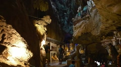 Pan buddha shrine in cave Stock Footage