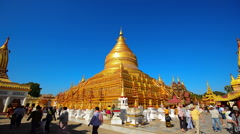 Tourist visiting Shwezigon pagoda in Bagan Stock Footage