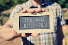 Man with a chalkboard with the text emotional intelligence Stock Photos