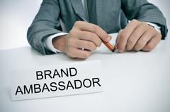 Man and name plate with the text brand ambassador Stock Photos