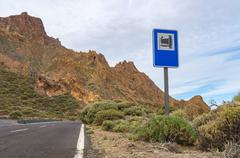 Attraction signpost standing near road Stock Photos