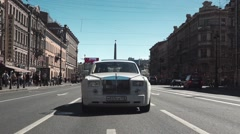 Rolls Royce Driving On City Street - stock footage