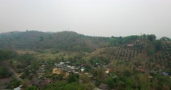 Rising crane aerial in north thailand with temple and countryside Stock Footage