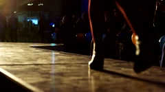 Model backlit goes on a fashion show at a night presentation. Stock Footage