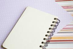 Open notebook on desk, on wooden table, can be used for your text or artwork, Stock Photos