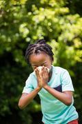 Boy sneezing his nose Stock Photos