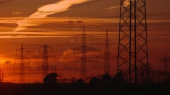 electrical power supply (electrical towers) with a sunset and red sky - stock footage