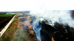 Aerial view of dry grass burning in steppe Stock Footage
